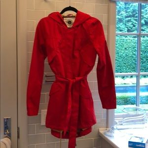 Cheery red raincoat with stylish lining and hood